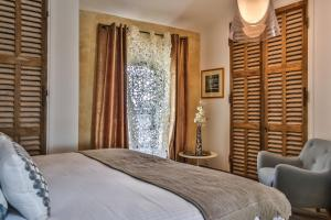 A bed or beds in a room at Apartments - Experience of PROVENCE