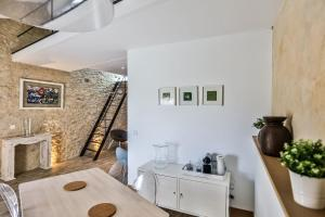 A kitchen or kitchenette at Apartments - Experience of PROVENCE