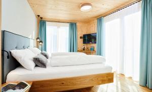 Ein Bett oder Betten in einem Zimmer der Unterkunft Hotel Gretina