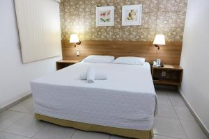 A bed or beds in a room at Hotel Ecos Classic