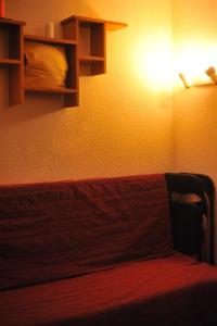 A bed or beds in a room at Studio Les Menuires Brelin