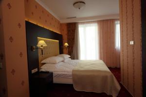 Ліжко або ліжка в номері Delice