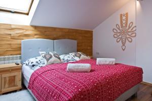 Łóżko lub łóżka w pokoju w obiekcie Apartament City Center Sky