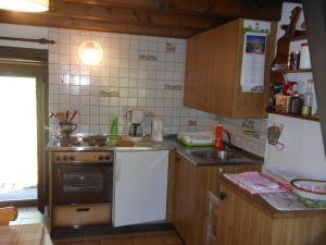 Küche/Küchenzeile in der Unterkunft Rustico Prati