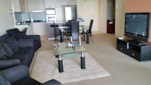A seating area at Grand Hotel Apartments Gold Coast by owner