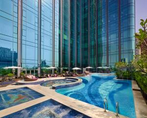 The swimming pool at or close to The Reverie Saigon