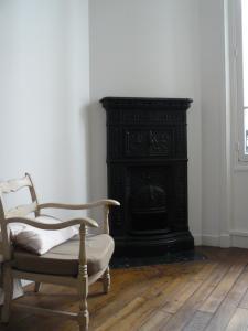 Posezení v ubytování La Cour du 5ème - Chambre d'hôtes