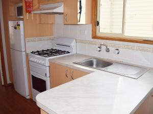 A kitchen or kitchenette at Cohuna Waterfront Holiday Park