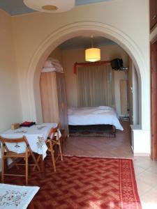 Ένα ή περισσότερα κρεβάτια σε δωμάτιο στο Guest House Ioanna Arachova