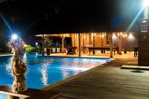 The swimming pool at or near Villa dos Corais