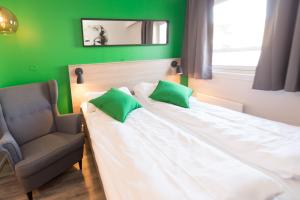 A bed or beds in a room at Fjordgaarden Mo