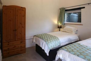 A bed or beds in a room at Little Trewin