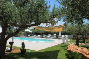The swimming pool at or near Case Vacanze Signorino Resort