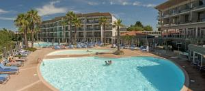 A view of the pool at Hotel & Spa Baie des Anges by Thalazur or nearby