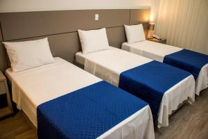 A bed or beds in a room at Ity Hotel