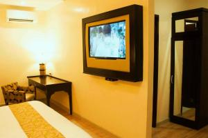 A television and/or entertainment center at Palm Grass Hotel