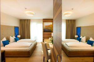 A bed or beds in a room at Hotel Wende