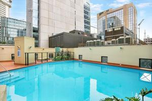 The swimming pool at or near One Bedroom Apartment Hosking Place - HOSK4