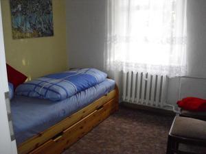 Ein Bett oder Betten in einem Zimmer der Unterkunft VierZeitHof - Hofcafé EisZeit