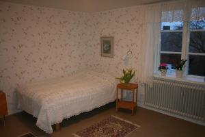 Säng eller sängar i ett rum på Fagerlid Gård