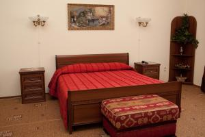 Кровать или кровати в номере Варваци Бутик Отель