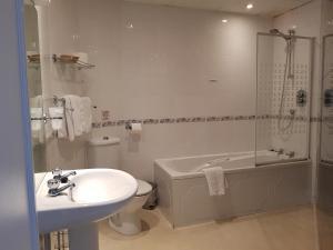 A bathroom at Burley Court Hotel