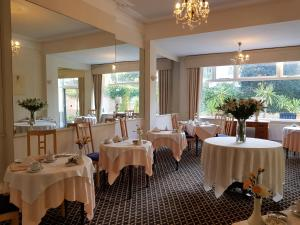 A restaurant or other place to eat at Burley Court Hotel
