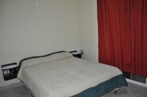 Una cama o camas en una habitación de Petronas del Mar 1