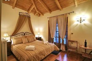 Ένα ή περισσότερα κρεβάτια σε δωμάτιο στο Αρχοντικό της Ζωής
