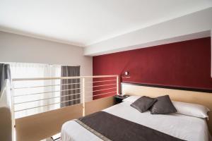 Letto o letti in una camera di Ibis Styles Milano Centro