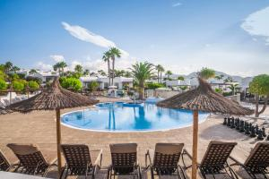 Piscina en o cerca de Jardines del Sol By Diamond Resorts