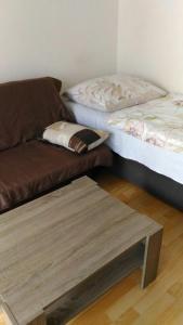 Postel nebo postele na pokoji v ubytování Apartmány Perla
