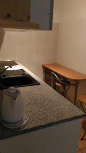 Kuchyň nebo kuchyňský kout v ubytování Apartmány Perla