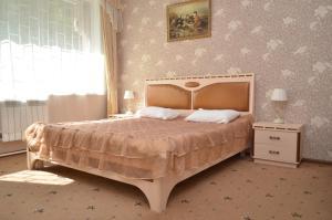 Кровать или кровати в номере Отель Люблю-но