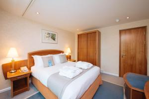 A bed or beds in a room at Arora Hotel Gatwick/Crawley
