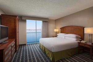 A bed or beds in a room at Embassy Suites San Francisco Airport - Waterfront