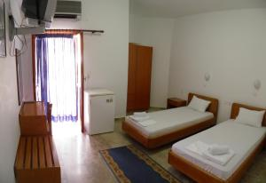 A bed or beds in a room at Samaria