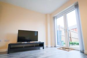 A television and/or entertainment center at Salford Media City Home with Free Parking