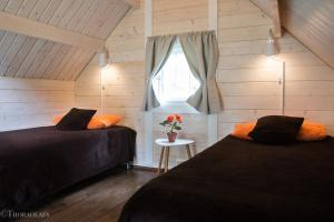 A bed or beds in a room at Glamping & Camping