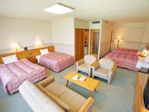 A bed or beds in a room at Tsumagoi Resort Sai no Sato