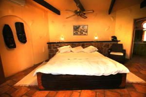 A bed or beds in a room at Mount Etjo Safari Lodge