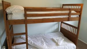 A bunk bed or bunk beds in a room at No Widemouth Bay Holiday Village