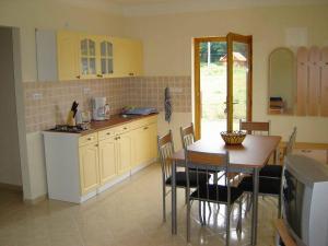 A kitchen or kitchenette at Dominika apartman