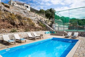 The swimming pool at or near Myrtos Bay Apartments