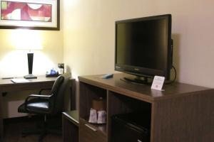 A television and/or entertainment center at Best Western PLUS Galleria Inn & Suites