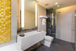 A bathroom at The Charm Resort Phuket