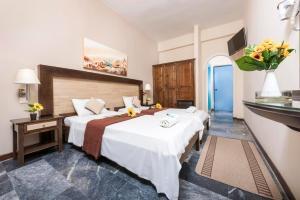 Un ou plusieurs lits dans un hébergement de l'établissement Potamaki Beach Hotel