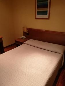 A bed or beds in a room at Hotel Dimora Adriana