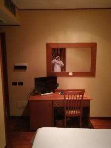 A television and/or entertainment center at Hotel Dimora Adriana