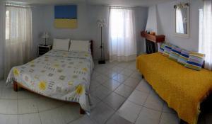 Ένα ή περισσότερα κρεβάτια σε δωμάτιο στο Mania Rooms and Studios